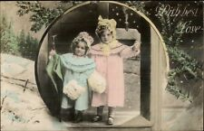Christmas (Untitled) Little Girls in Winter Coats Tinted Real Photo Postcard