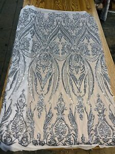 SILVER DAMASK SEQUINS DESIGN ON A WHITE 4 WAY STRETCH  MESH-PROM-BY YARD.