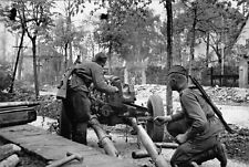 WWII Soviet artillerymen are firing on the street in the suburbs of Berlin//36m