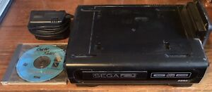 Sega CD Model 1 US Region with AC Adapter And Sewer Shark (GENESIS NOT INCLUDED)