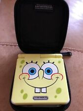 gameboy advance sp spongebob edition and 12 games  with 2 cases