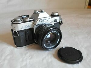 Canon AE-1 Classic SLR camera 35mm working order withFD lens 50mm 1:1.8