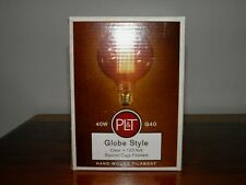 PL&T, 40 W, globe style, clear 120 V, squirrel cage filament light bulb.