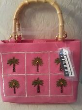 TIANNI BRAND. PINK PURSE WITH PALM TREES ON IT, WITH BAMBOO HANDLES.