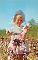 WHITE GOLD OF DIXIE~BLONDE GIRL PICKS SOUTHERN COTTON~AGRICULTURE POSTCARD 1960s