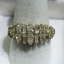 14k Gold Lady's Ring With Round And Baguette Diamonds