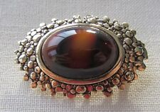 Vintage gold tone Sarah Coventry brooch with brown stone