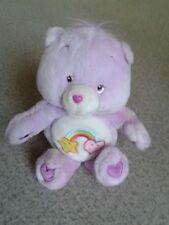 Purple Soft Cuddly Care Bear which Plays Nursery Rhymes