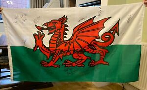 Wales Flag Signed By 16 Welsh Stars inc John Charles, Rush, Southall, Calzaghe