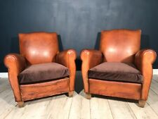 Antique pair of leather club chairs