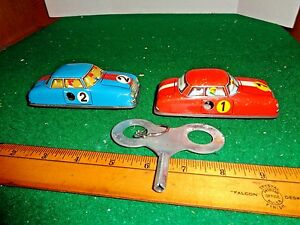 Lot of Two 1950's Key Wind Up Tin Litho Race Cars with Cragstan Oversized Key