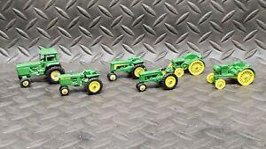 Lot of mostly 1/64 john deere tractors
