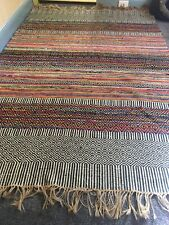 Used woven jute/cotton multicoloured floor rug. 150cm x 210 cm.