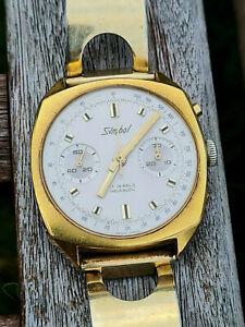 Symbol Chronograph 70er Jahre,vergoldet, Landeron 248, Werk läuft gut, für Teile