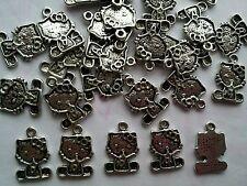 50 X Tibetan Silver  Hello Kitty Charms