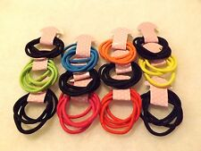 100 pcs Hair Ties Pony Tail Holders Diffrent Colors .