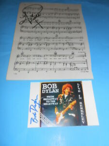 old prince autographed music page with bob dylan autographed photo