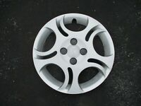One factory original 2003 to 2006 Saturn Ion bolt on 15 inch hubcap wheel cover