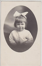 CUTE GIRL WITH BIG HAIRBOW. VINTAGE REAL PHOTO POSTCARD