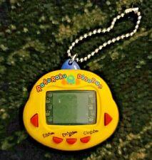 Original RakuRaku DinoKun Dinkie Dino Electronic Virtual Pet TK-910 (Yellow)