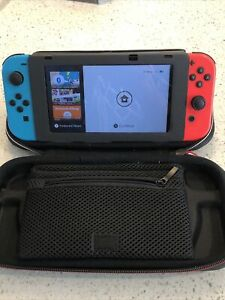 Nintendo Switch 32GB Console with Neon Red and Neon Blue Joy-Con Only W/extras