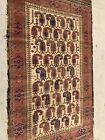 AN ATTRACTIVE IVORY BACKGROUND COLOR BALUCHSTAN TRIBAL RUG, BOTEH DESIGN