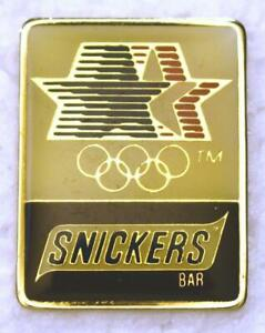 """Snickers 1984 Los Angeles Olympics 1-1/8"""" x 7/8"""" Stars in Motion Collector's Pin"""