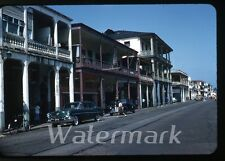 1957 red border kodachrome Photo slide Colon Panama street scene car automobile