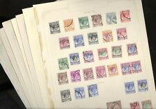 MALAYSIA, Assortment of Stamps hinged on pages