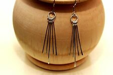 Hand made sterling silver earrings with silver eye catching moving shards,