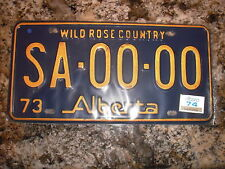 1973 ALBERTA SAMPLE LICENSE PLATE WITH 74 STICKER