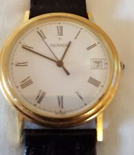 MENS  MOVADO  Solid 14 k  Solid GOLD, Swiss, Sapphire Crystal, Date Watch