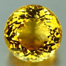 A PAIR OF 4mm ROUND-FACET NATURAL BRAZILIAN GOLDEN CITRINE GEMSTONES