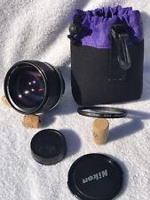 [N. Mint] Nikon AIs Nikkor 85mm f/1.4 Portrait Lens, caps sky filter & bag