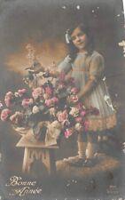 Fillette au bouquet de fleur