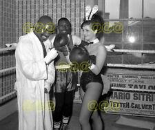 Photo - Bunny girl spars with Rubin Carter & Joe Brown, London, 1965