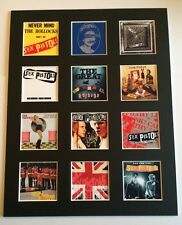 "SEX PISTOLS 14"" BY 11"" LP DISCOGRAPHY COVERS PICTURE MOUNTED READY TO FRAME"