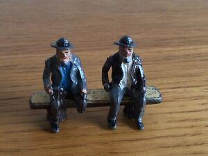 Vintage Men On A Log Bench