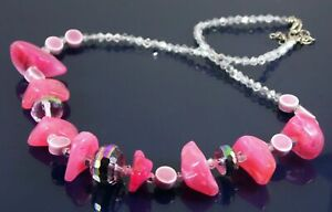 Statement necklace with iridescent faceted crystal ceramic and pink lucite beads