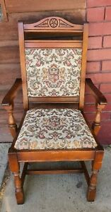 Antique Carver Chair With Tapestry Upholstery Featuring Coat Of Arms