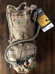 CAMELBACK Ambush Backpack 100OZ.3L Hydration Bladder-Desert Camo w/(BONUS HOSE)