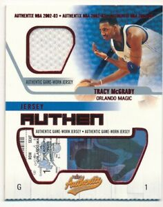 TRACY MCGRADY 2002/03 FLEER AUTHENTIX RIPPED MAGIC RELIC GAME USED JERSEY SP