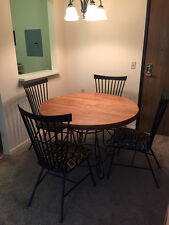 """oak and metal dining table and chairs, table is 44"""" in diameter"""