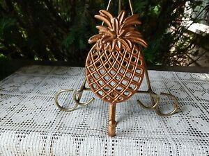 """Cast iron wall hanger / trivet pineapple shape brass color 2 footed 7.5"""" x 3.75"""""""