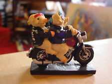 2 pigs on harley statue