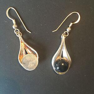 A0937 Pair of onyx drop earrings in stylised pear shape settings in Silver