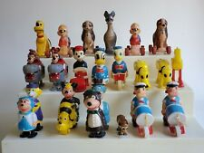ASSORTMENT VINTAGE DISNEY RAMP WALKERS AND TOYS ON WHEELS LOT (21)