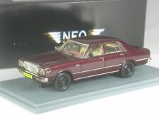 Klasse: Neo Scale Models Datsun Laurel  braunrot metallic in 1:43 in OVP