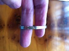 Silver expandable baby's bangle Has ABC around the outside of bangle Christening