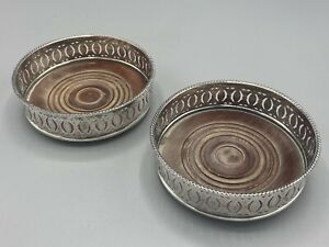 A Matching Pair Of Siler Plated (no Hallmarks) Wine Coasters